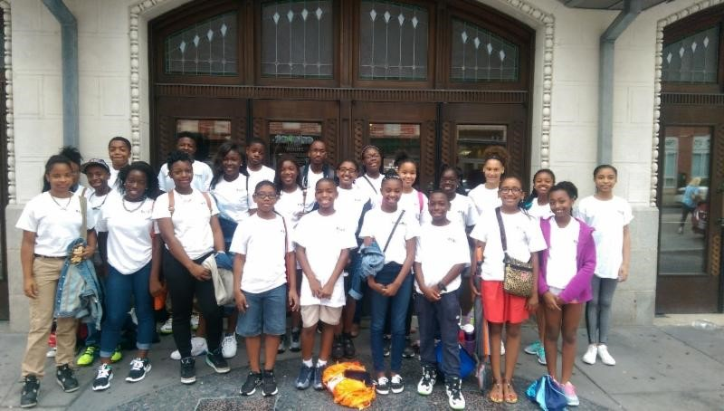 B.E.S.T. Summer Scholars in front of the Hippodrome Theatre during their field trip to Camp Hippodrome